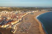 Beautiful Aerial View On Town Nazare In Portugal. Sunset Above Coastline. poster