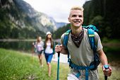 Group Of Smiling Friends Hiking With Backpacks Outdoors. Travel, Tourism, Hike And People Concept. poster