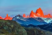The grand crimson dawn over the mountain range Fitzroy. Mountain peak in Patagonia. Magnificent moun poster