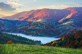 Magical Sunrise In Mountains. Valley Full Of Fog. Beautiful Autumn Scenery. Trees In Colorful Foliag poster