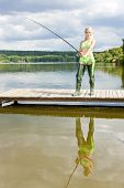 foto of fisherwomen  - fishing woman standing on pier - JPG