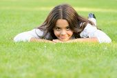 Kid Relaxing Outdoors. School Break For Rest. Adorable Pupil. Girl Kid Laying Green Grass. Girl Scho poster