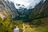 Scenic Mountain Panorama With Green Meadows And Idyllic Turquoise Lake Oberer poster
