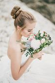 Young Beautiful Bride Posing With Wedding Bouquet With Gorgeous Nature View On The Background. poster
