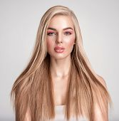 Portrait of a blonde beautiful woman with a long straight light hair. Portrait of a beautiful woman  poster