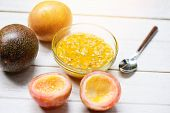 Fresh Passion Fruit Juice On Wooden Table For Passion Fruit Smoothie poster