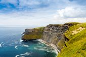 Spectacular Cliffs Of Moher Are Sea Cliffs Located At The Southwestern Edge Of The Burren Region In  poster