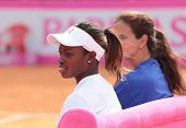 KHARKIV, UKRAINE - APRIL 19: Sloane Stephens and Mary-Joe Fernandez watch training during Fed Cup Ti