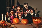 Happy Family Mother Father And Children In Costumes And Makeup On A Celebration Of Halloween poster
