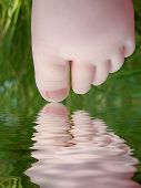 picture of baby feet  - Reflection of a leg of the baby in water - JPG