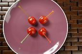 Tomatoes Snack In A Purple Dish And Colored Sticks poster