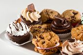 image of brownie  - plate full of an assortment of cookies and mini brownie bites