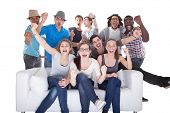 foto of rapture  - Group Of Friends Enjoying Watching Television On White Background - JPG