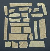 pic of gey  - collection of various adhesive tape pieces on black background - JPG