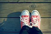 foto of pink shoes  - Pink tennis shoes on a beach boardwalk - JPG