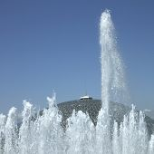 picture of ejaculation  - Tall water fountain in front of a dome - JPG