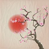 Bough of a cherry blossom tree against red sun. Crumpled paper vintage effect. EPS10 vector format.