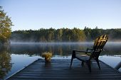 stock photo of calm  - Morning view of the bay from the dock at Weslemkoon lake - JPG