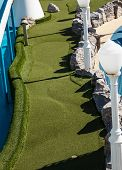 stock photo of miniature golf  - Green imitation grass of a miniature golf course on a cruise ship - JPG