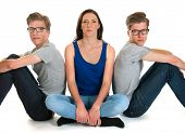 stock photo of identical twin girls  - Identically adult male twins with girl  in studio - JPG