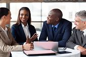stock photo of multicultural  - modern business partners having meeting - JPG