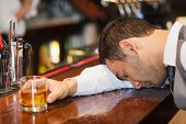 picture of over counter  - Drunk businessman lying on a counter in a classy bar - JPG