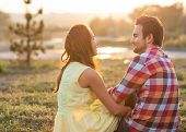 stock photo of fall day  - Young couple in love outdoor in the sunlight sunset - JPG