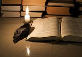 image of gospel  - Gospel New Testament candle and other books on a marble table - JPG