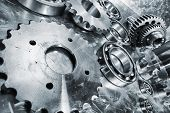 stock photo of titanium  - aerospace titanium and steel engineering gears and cogs - JPG