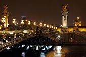 The Alexander III bridge across river seine at night in Paris, France