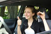 Happy teenager having key car in hands