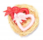 Decorative hearts in nest, isolated on white