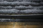 stock photo of gutter  - Gutter leaking water after a hailstorm in spring time - JPG