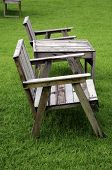 stock photo of lawn chair  - Wooden chair in the garden with a lawn in the background - JPG