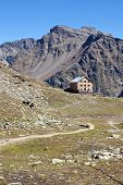 foto of chalet  - The photo shows beautiful panorama with chalet from Alps  - JPG
