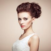stock photo of headdress  - Portrait of beautiful sensual woman with elegant hairstyle - JPG