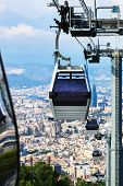 stock photo of ropeway  - a beautiful modern ropeway against Barcelona - JPG
