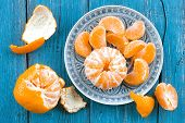 picture of mandarin orange  - Mandarin orange on a plate on a table - JPG