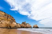 pic of lagos  - Rocky cliffs on the coast of the Atlantic ocean in Lagos Algarve Portugal - JPG