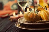 stock photo of halloween  - Autumn table setting with pumpkins - JPG