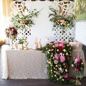 stock photo of dowry  - Floral arrangement to decorate the wedding feast the bride and groom - JPG
