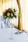 stock photo of dowry  - Floral arrangement for decoration wedding table for guests. Room table. Vintage