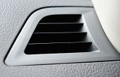 stock photo of dash  - Modern car air vent close up on dash of car - JPG