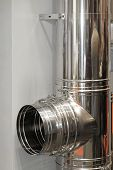 stock photo of exhaust pipes  - Stainless steel chimney stove pipe home installation - JPG