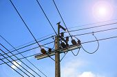 image of sun perch  - electric cable on concrete pole with sun light - JPG