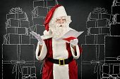 Image of santa claus reading an invoice.