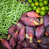 pic of lime-blossom  - Fresh beans banana flowers and lime for sale at asian market - JPG