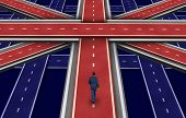 picture of directional  - British plan and the future of Great Britain including England Scotland and Wales as a concept of the direction of the british economy and economic path of the United Kingdom as a businessman walking on a group of roads shaped as a flag - JPG