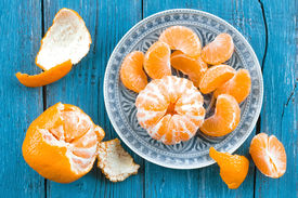 stock photo of mandarin orange  - Mandarin orange on a plate on a table - JPG