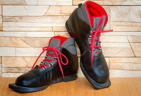 stock photo of ski boots  - Black boots with red finishing for skiing - JPG